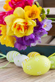 Easter eggs and posy  of spring flowers on wooden Stock Photos