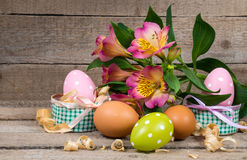 Easter eggs in a pot and flower Stock Image