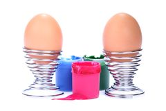 Easter eggs with pots of paint Royalty Free Stock Photography