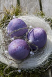 Easter eggs in purple with white pearls Royalty Free Stock Photography