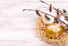 Easter eggs and pussy willow branch right. Easter eggs and pussy willow branch on a wooden background right side Stock Images