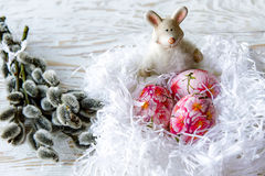 Easter eggs with pussy willow on light background. Decoupage Royalty Free Stock Photography