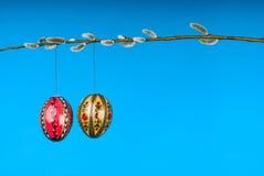 Easter eggs on willow twig horizontal Stock Photos