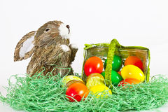 Easter Eggs with rabbit. Some Colorful Easter Eggs did fall out of a green Basket stock photography