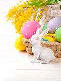 Easter eggs with rabbit and branch mimosa Royalty Free Stock Photo