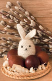 Easter eggs and rabbit on catkins background Stock Photos