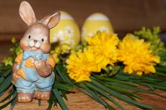 Easter eggs, rabbit and colorfol flowers Stock Images