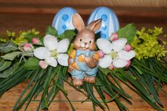 Easter eggs, rabbit and colorfol flowers Royalty Free Stock Image