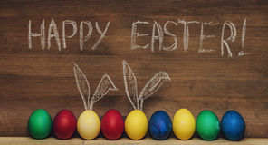 Easter eggs with rabbit ears on a wooden background textures, ho stock images