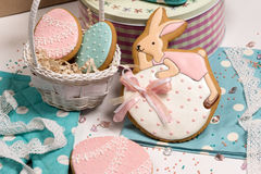 Easter eggs and rabbit honey-cake, sweet color background kitchen Stock Photos