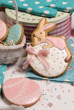 Easter eggs and rabbit honey-cake, sweet color background kitchen Royalty Free Stock Image