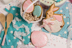 Easter eggs and rabbit honey-cake, sweet color background kitchen Stock Images