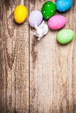 Easter eggs and rabbit on old wooden Stock Photo