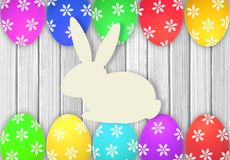 Easter eggs and rabbit over white wooden table Stock Photography