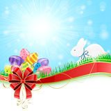 Easter eggs with rabbit and red bow Royalty Free Stock Photo
