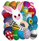 Easter eggs and rabbit. White Easter rabbit in eggs Stock Image
