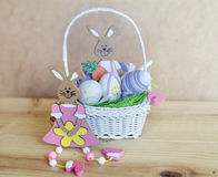 Easter eggs and rabbits    in small white basket Royalty Free Stock Image