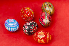 Easter eggs on red background vertical. Easter eggs on red paper background Royalty Free Stock Photos