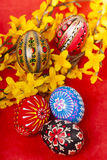 Easter eggs on red background vertical Stock Image