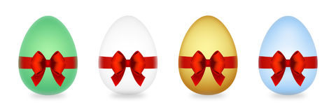 Easter eggs with red bow isolated on white Stock Photos