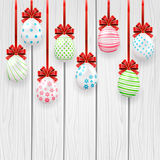 Easter eggs with red bow on wooden background Royalty Free Stock Photography