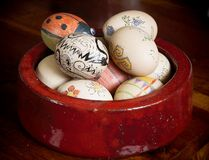 Easter eggs in red bowl. Painted with modern patterns Royalty Free Stock Photo