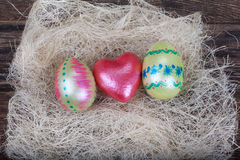 Easter eggs with  red heart symbol in natural nest Royalty Free Stock Photos