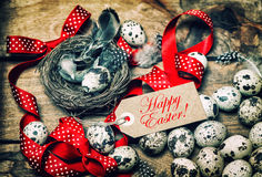 Easter eggs red ribbon bow Happy Easter vintage vignette Stock Photography
