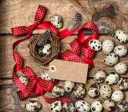 Easter eggs with red ribbon bow and tag Royalty Free Stock Photos