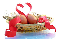 Easter eggs and red ribbon in the form of heart Stock Photography