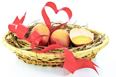 Easter eggs and red ribbon in the form of heart Stock Image