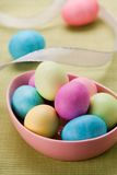 Easter Eggs & Ribbon. Pink bowl of pastel Easter eggs with ribbon Stock Photos