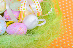 Easter eggs and ribbon in nest Stock Photography