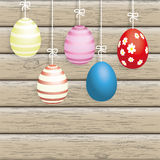 5 Easter Eggs Ribbon Wood. 5 easter eggs on the wooden background Royalty Free Stock Photography