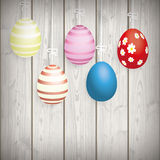 5 Easter Eggs Ribbon Wooden Wall. 5 easter eggs on the wooden background Royalty Free Stock Photos