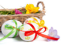Easter eggs with ribbons in basket Royalty Free Stock Photography