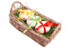Easter eggs with ribbons in basket Royalty Free Stock Images