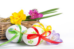 Easter eggs with ribbons in basket Royalty Free Stock Photo