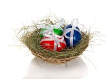 Easter eggs with ribbons in nest Stock Photography