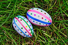 Easter eggs with ribbons and sequins on grass Stock Image