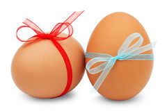 Easter eggs with a  ribbons on white background Stock Photo
