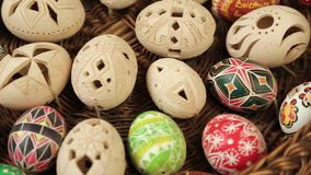 Easter eggs rolling around text Happy Easter stock video footage