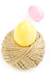 Easter eggs and rolling ball of hemp rope isolated on white Stock Photos