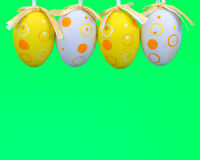 Easter eggs on rope on colorful wooden background. Easter backgr Royalty Free Stock Photos