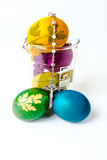 Easter eggs with rosary on lab glass Royalty Free Stock Photography