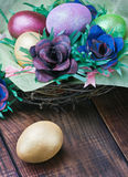 Easter eggs and rose from the egg packaging Royalty Free Stock Image
