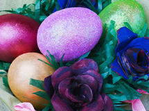 Easter eggs and rose from the egg packaging Stock Images