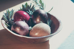 Easter eggs  with rosemarry in the bowl on wooden table Stock Photography