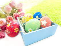 Easter eggs and roses. On the white background Stock Images