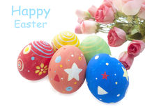 Easter eggs and roses. On the white background Royalty Free Stock Photo
